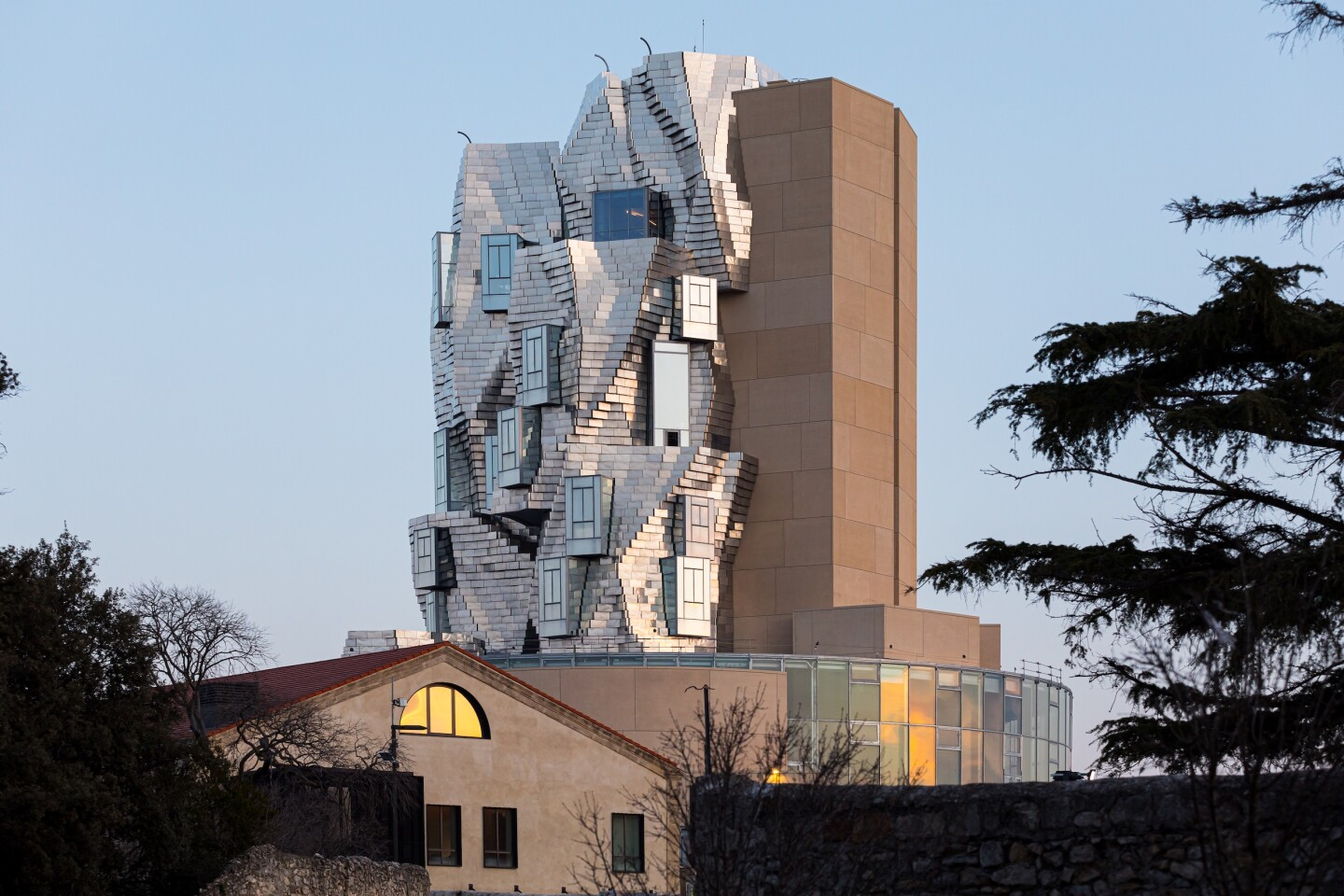 The Luma Arles tower rises to a height of 56 m (183 ft)