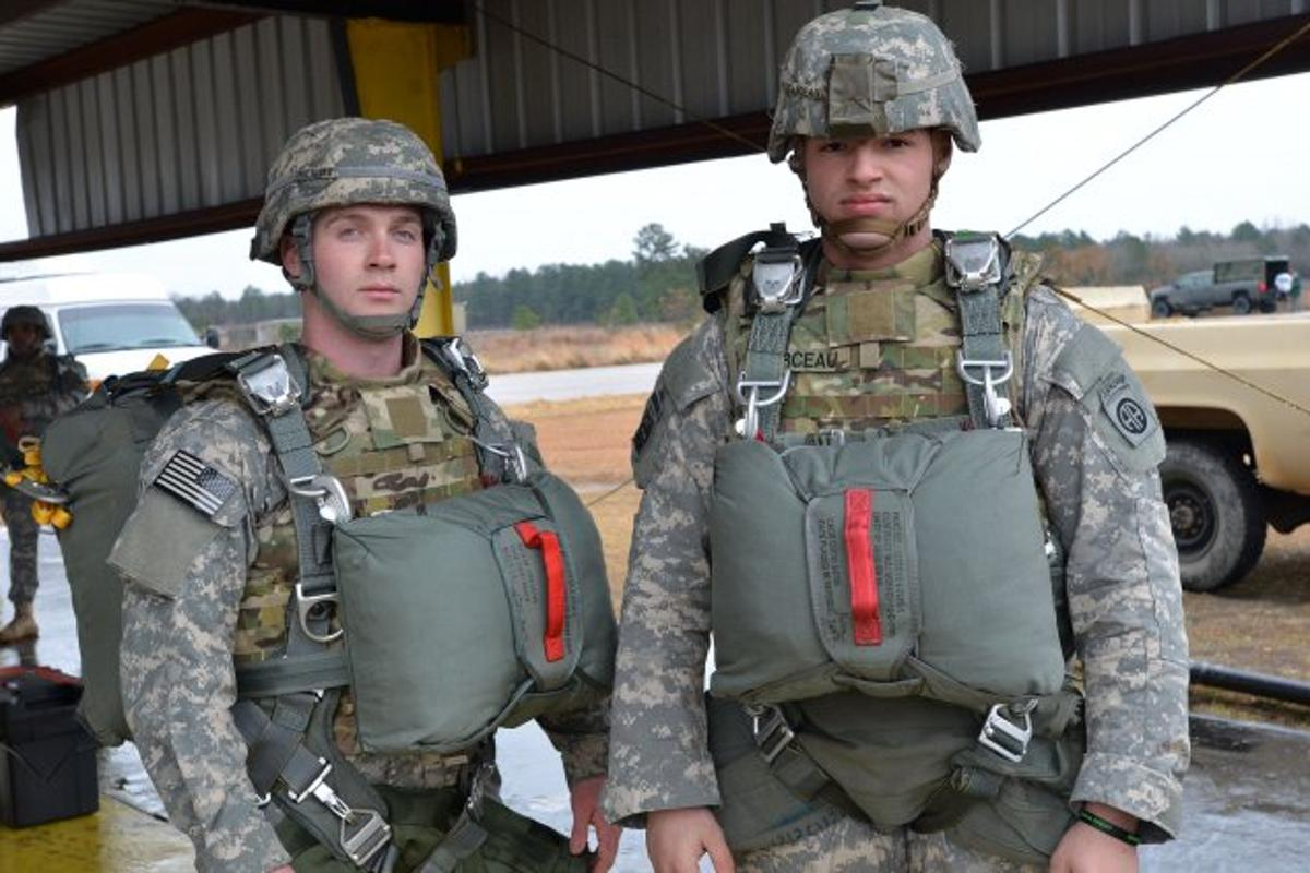 Paratroopers in T-11 parachutes and teh IOTV armored vest