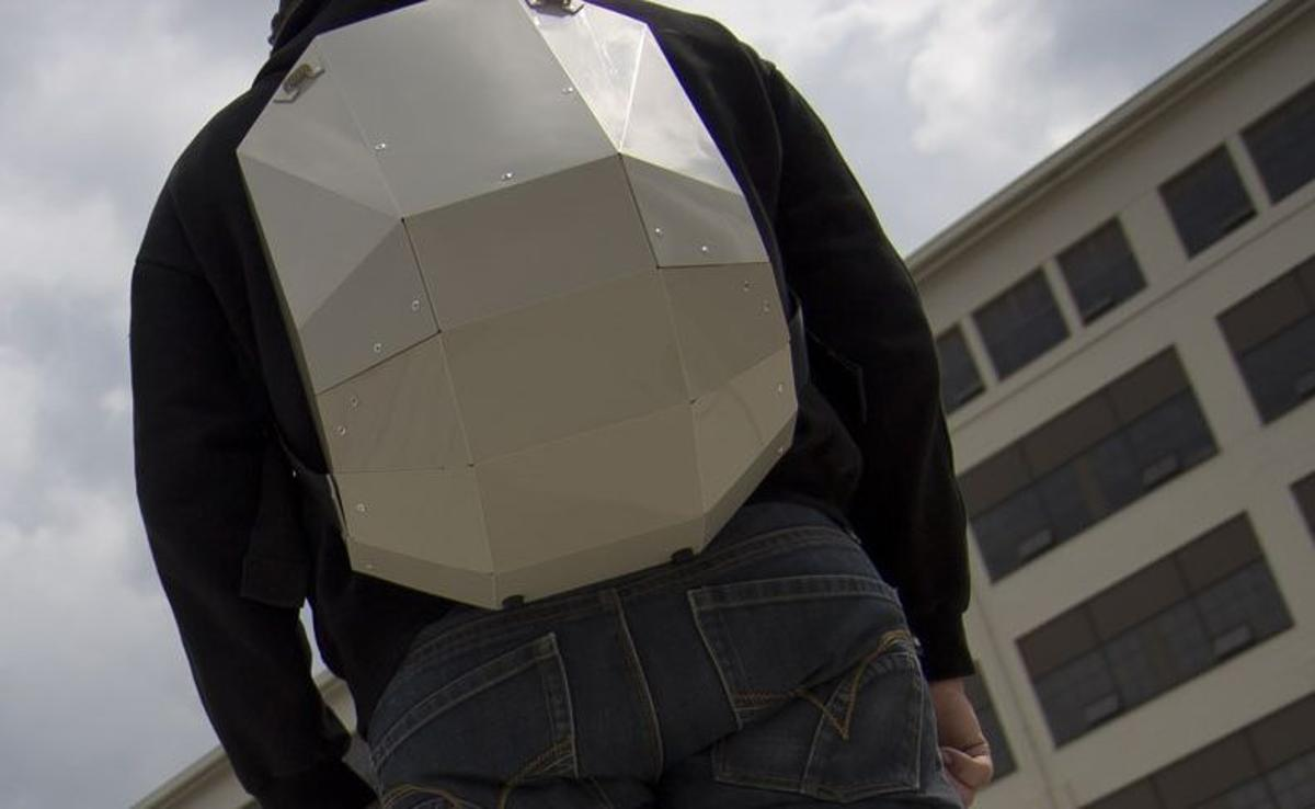 The Solid Gray backpack features a rigid foldable design, and is made from a single sheet of copolymer