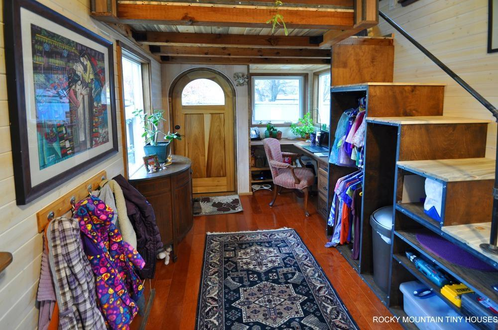 We rarely get to see a tiny house that's actually lived in by a family so these photos of the Red Mountain 34' Tiny House are very useful