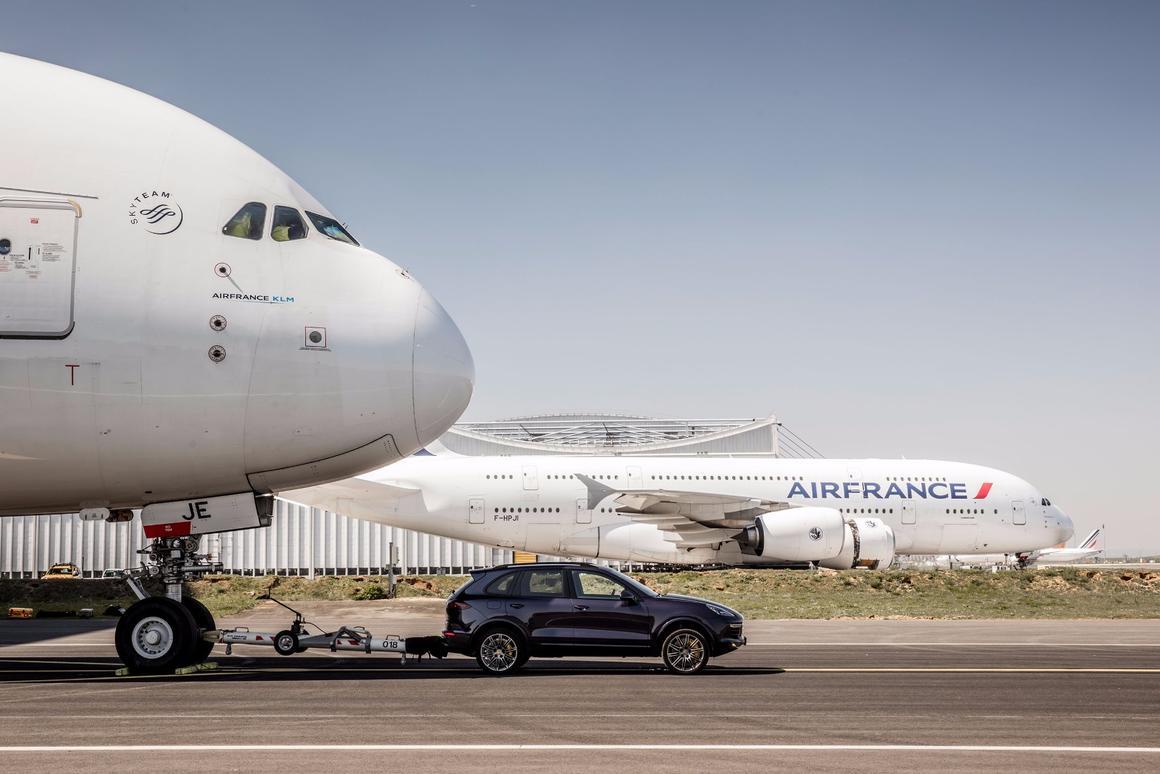 An Air France A380 being pulled by a Porsche Cayenne S Diesel