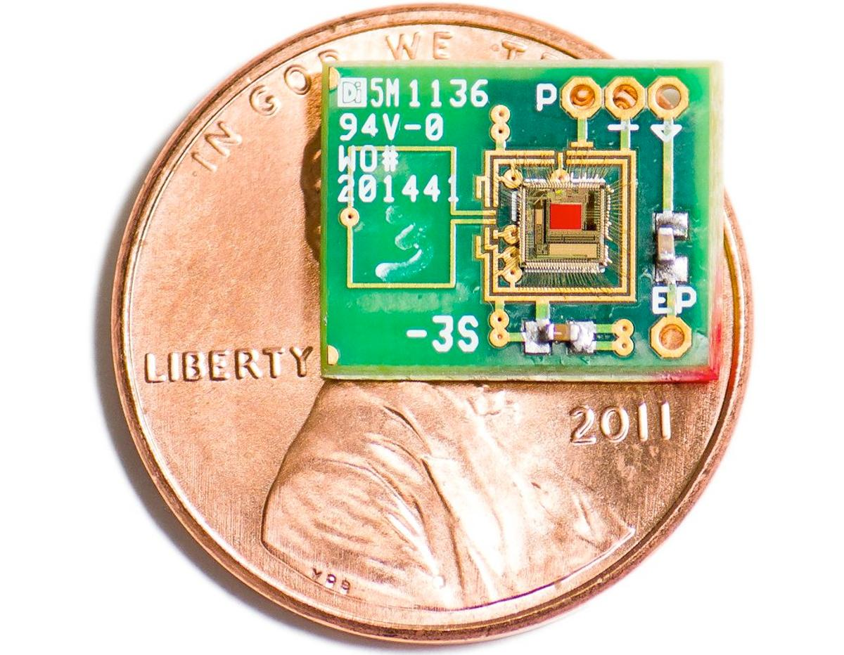 An experimental ear-powered chip, with a penny for scale
