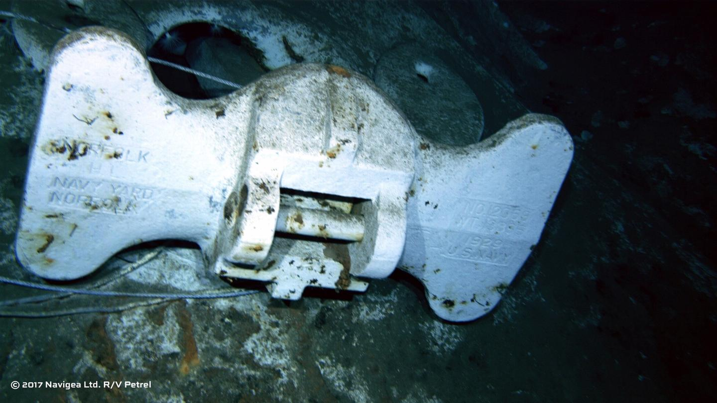 "An image shot from a remotely operated vehicle shows the bottom of an anchor clearly marked ""US Navy"""
