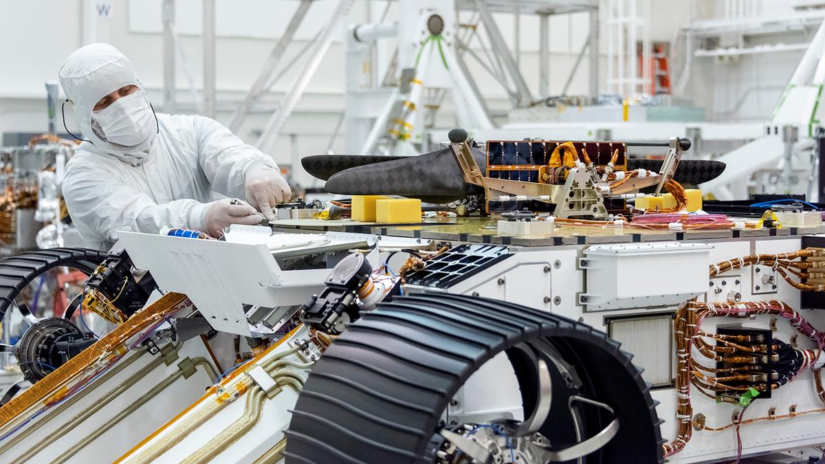 The Mars 2020 rover pictured upside down as engineers work to attach the helicopter payload