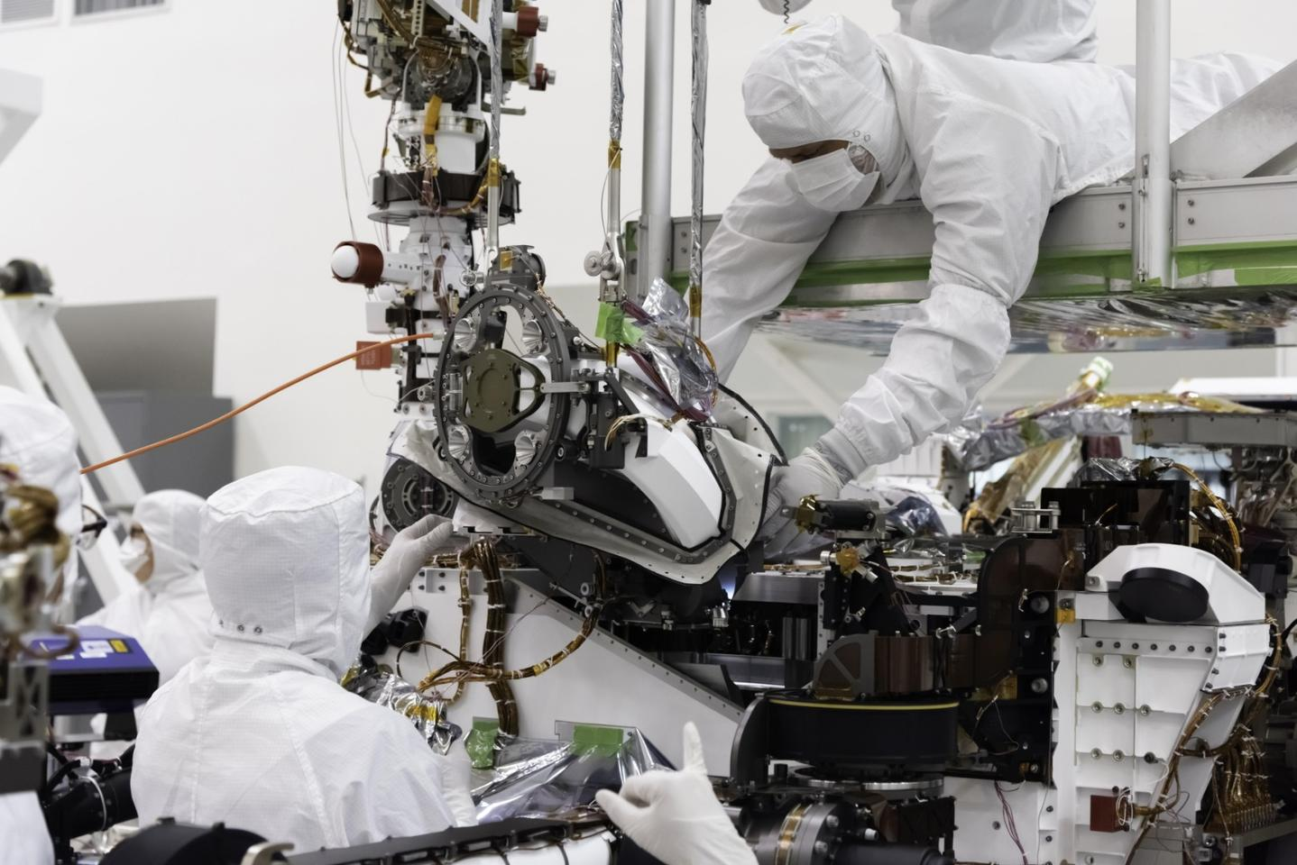 The bit carousel, which lies at the heart of Sample Caching System of NASA's Mars 2020 mission, is attached to the front end of the rover in the Spacecraft Assembly Facility's High Bay 1 at the Jet Propulsion Laboratory in Pasadena, California