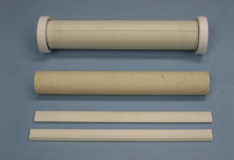 The plasmonic metamaterial cloak (top) and some of components used to make it (Photo: Andrea Alù)