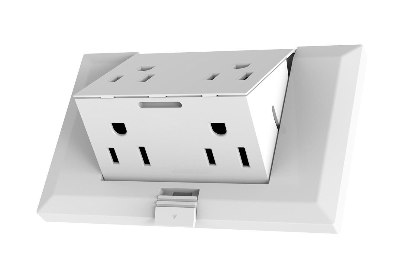 "A button on theOUTlet allows the central unit to ""pop out"" from the rest of the fitting, providing two additional sockets"
