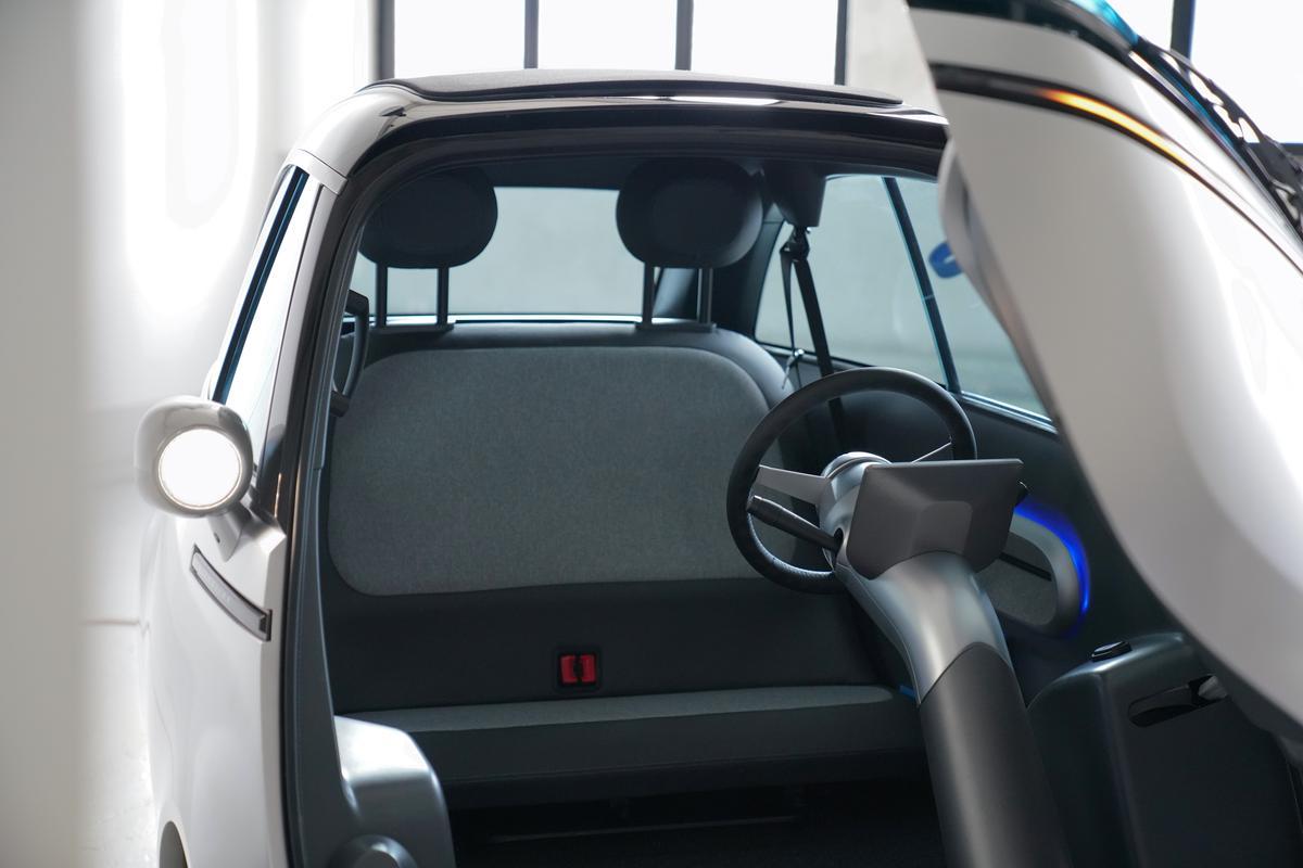 The steering column has been moved from the door to the floor