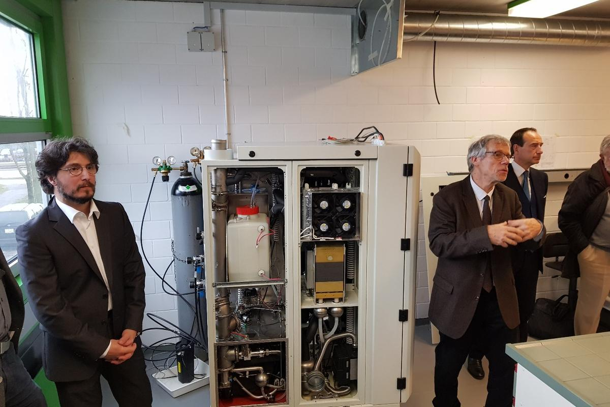 Researchers at EPFLand GRT Group have developed a promising prototype of a formic acid-based fuel cell. From left: Dr. Nordahl Autissier, GRT Group Senior Project manager; Prof Laurenczy, EPFL, Prof Eng. Luca Dal Fabbro, GRT Group CEO.