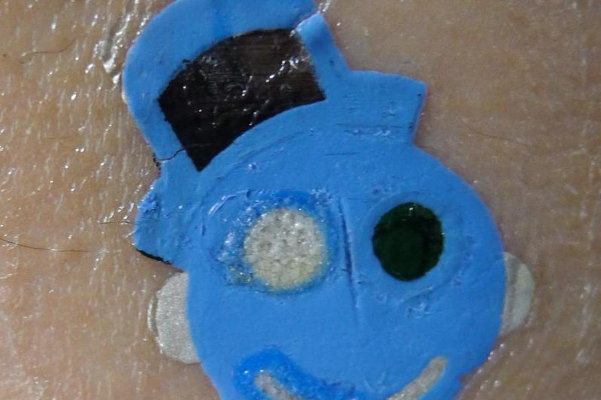 """The tattoo-based solid-contact ion-selective electrode – or """"smiley-face tattoo,"""" if you prefer (Photo: University of Toronto)"""