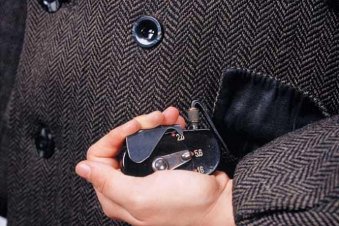 Coat with buttonhole camera
