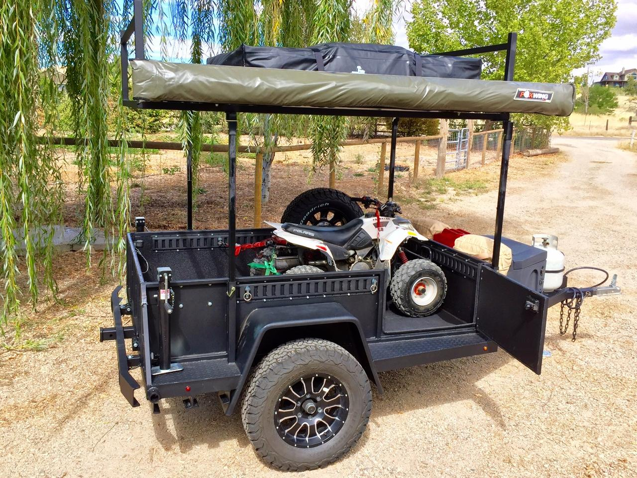 With just its bed and roof-top tent platform, the UGOATScout serves as a gear hauler and basic camping trailer