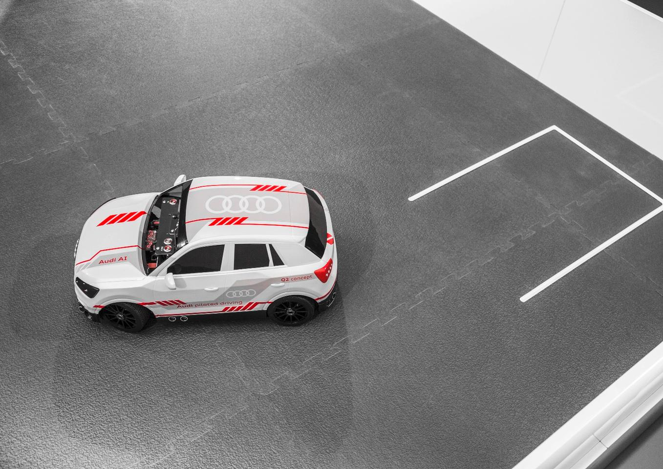 The 1:8-scale model Audi parks within a model parking lot