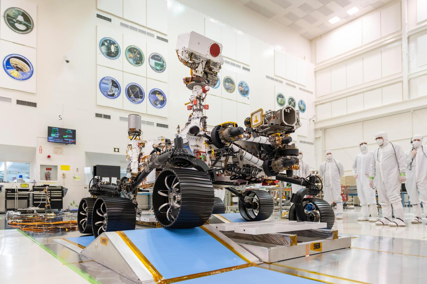 In a clean room at NASA's Jet Propulsion Laboratory in Pasadena, California, engineers observed the first driving test for NASA's Mars 2020 rover