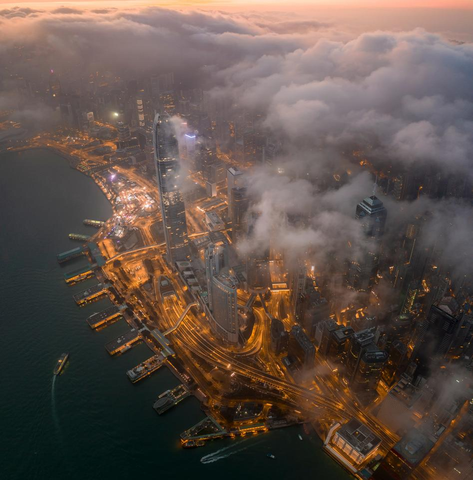 The view of the world famous Victoria Harbour (Hong Kong) under the clouds in the early morning.