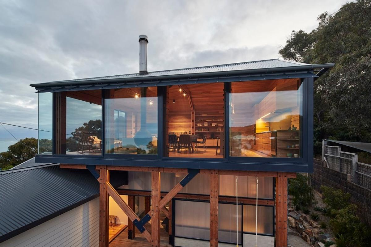 Austin Maynard Architects crafted a timber box partly over the old shack but leaving the older home untouched