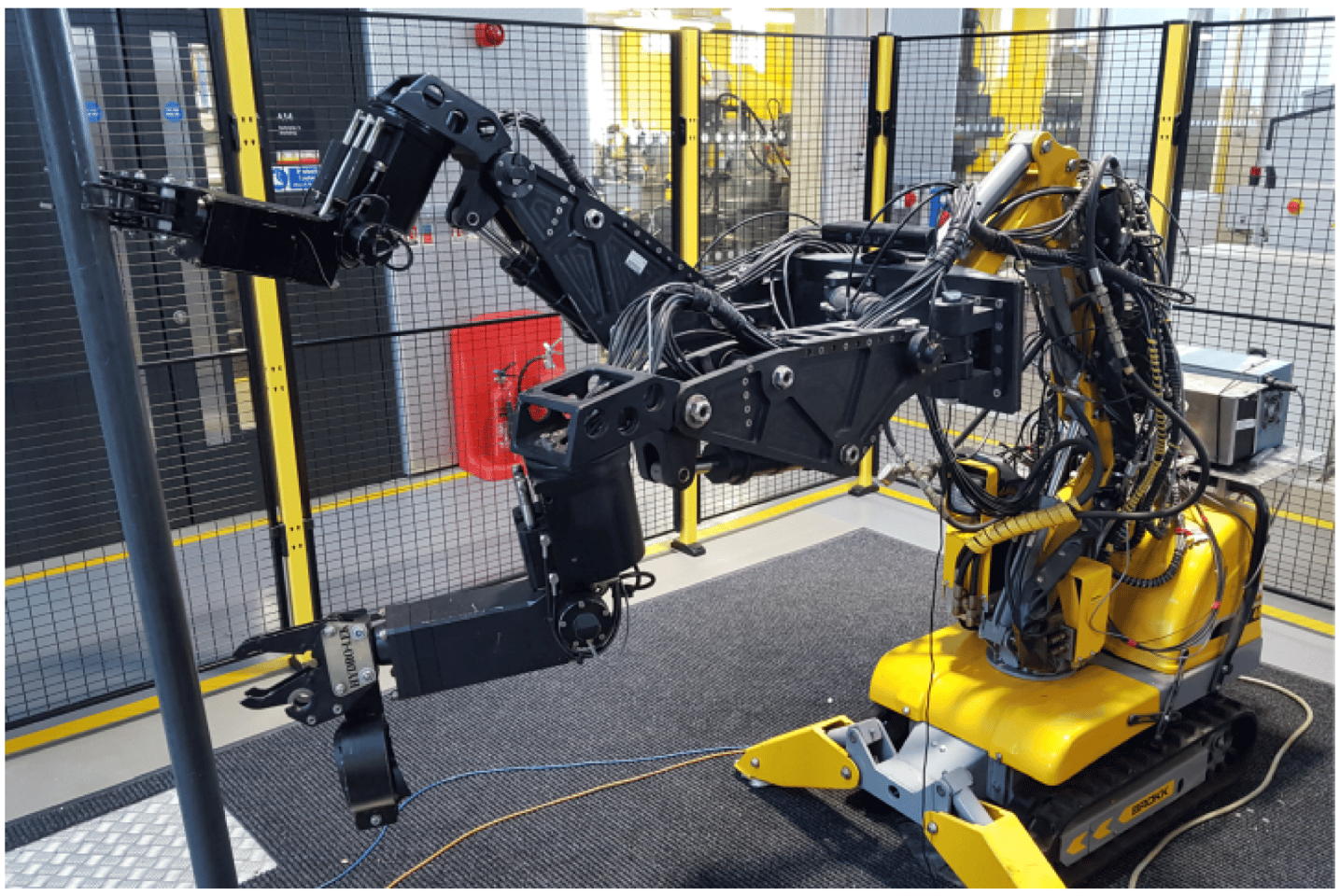 The mobile robot with manipulating arms grasping a pipe