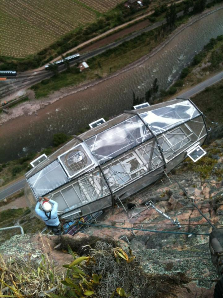 The capsule-style aluminum and polycarbonate suites are located on a cliff face in Peru's Sacred Valley