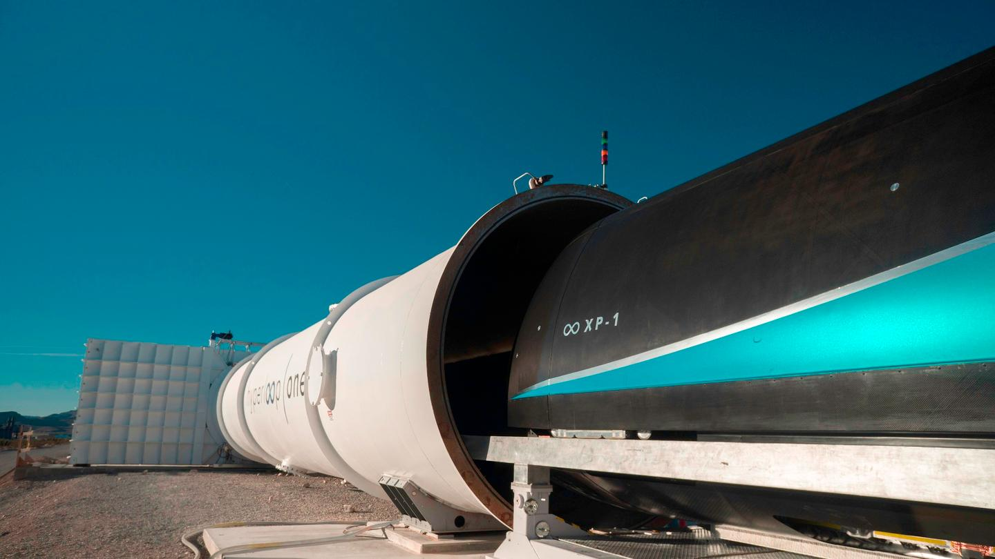 The prototype travel pod being loaded into the test cylinder