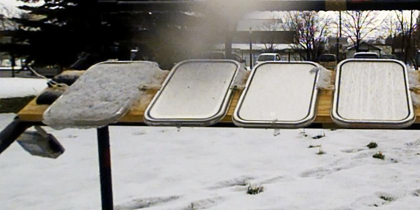 SLUGs coatings repel snow and ice on the right three panels, while it builds up on the far left untreated panel