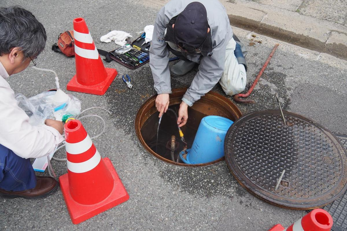Scientist collect groundwater from a well near the site of this year's Kumamoto earthquake