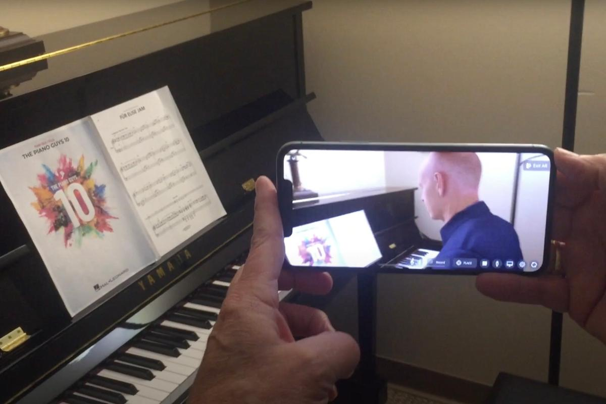 Jon Schmidt from The Piano Guys has been digitized to create a realistic 3D avatar that can be seated at a home piano via a mobile app