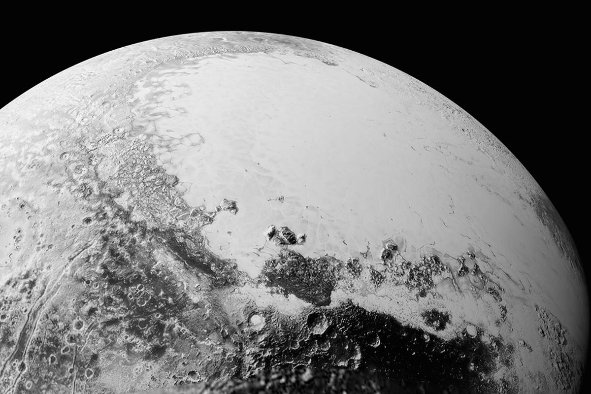 Synthetic perspective view of Pluto based on images from New Horizons show a 1,100-mile (1,800-km) swathe of terrain