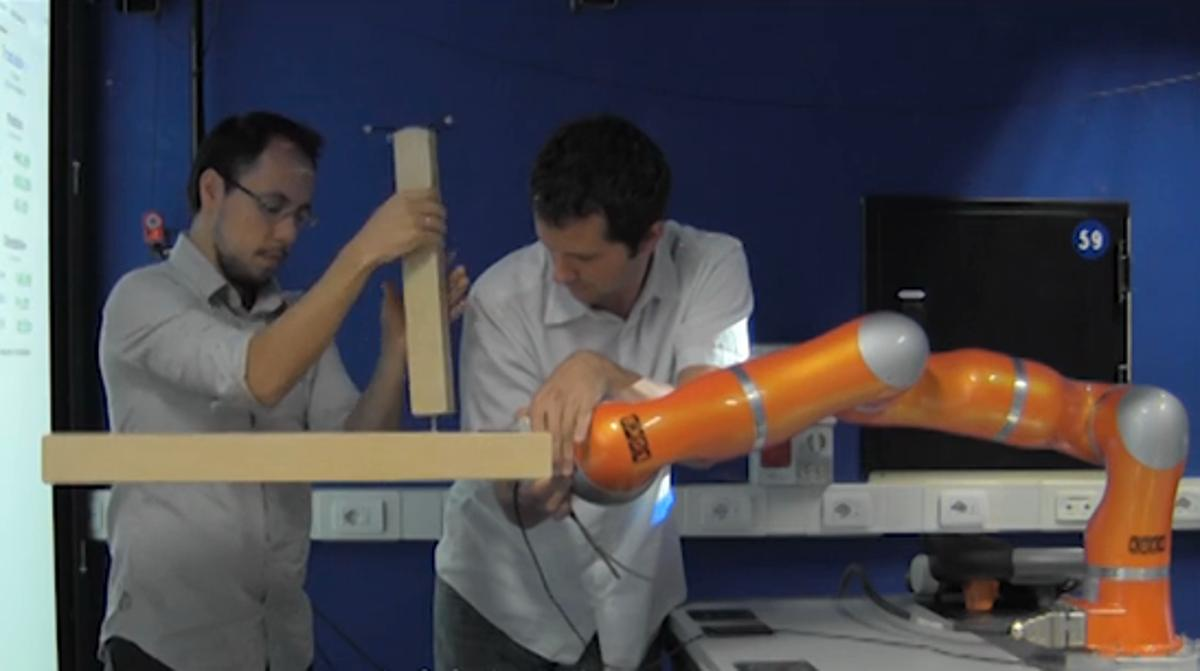 Italian researchers have developed a robot that can be taught to build an IKEA table (Photo: IIT)