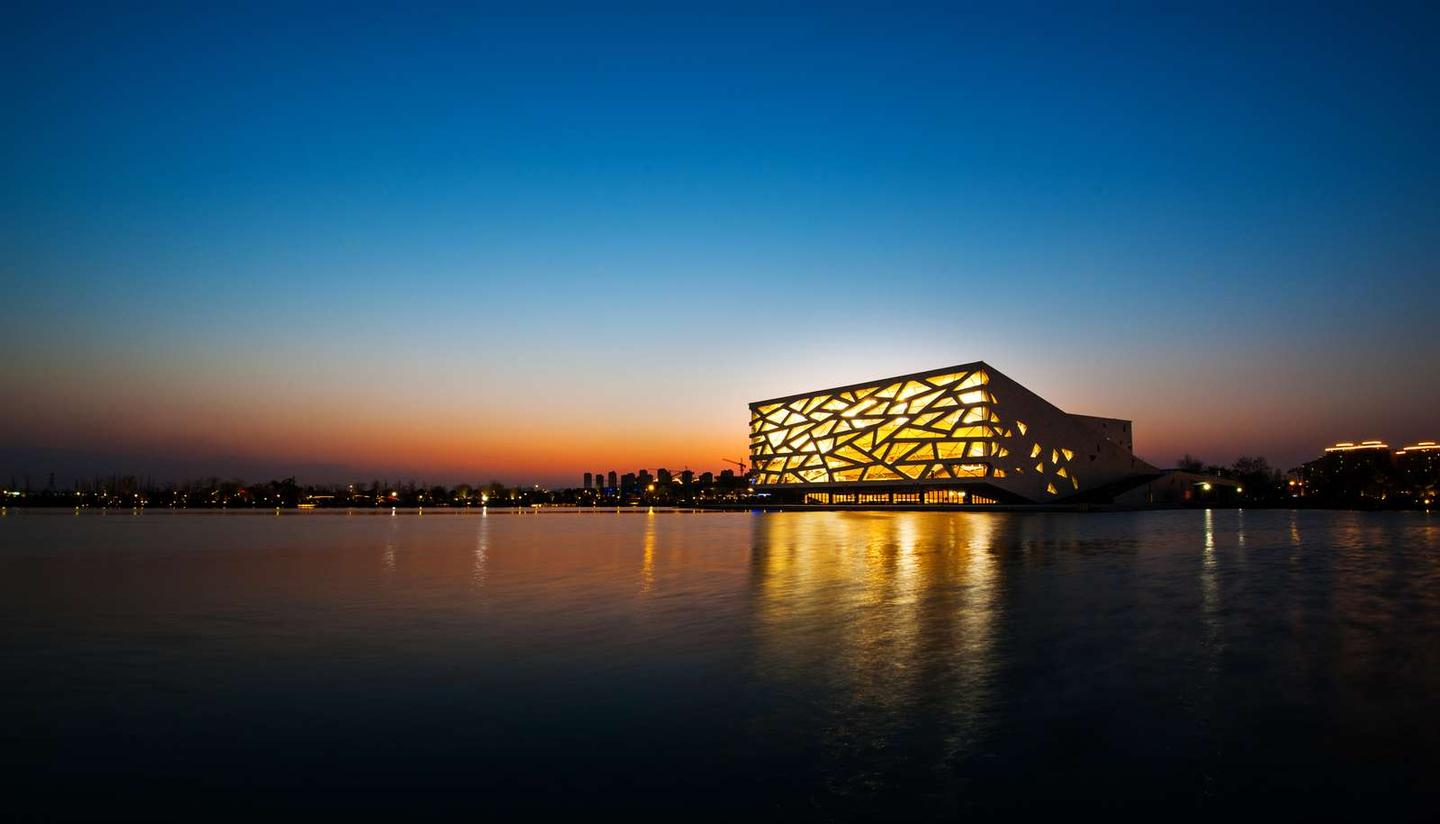 The Hangzhou Yuhang Opera also involved Hangzhou Architectural & Civil Engineering Design Institute Co. and Buro Happold Engineering, plus Bassinet Turquin Paysage and AECOM for landscaping
