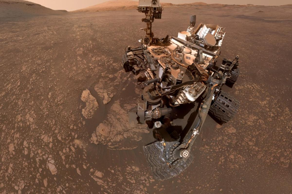 Curiosity took this selfie on May 12. The two drill holes in the clay-bearing region can be seen to its lower left