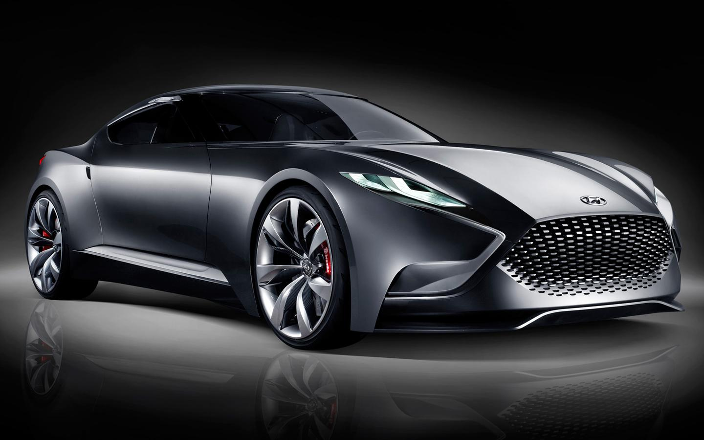 Aston Martin-like grille treatment, 'Vette rear haunchings, and a dab of Miura concept and 370Z elements influence the HND-9's fluidic body treatment