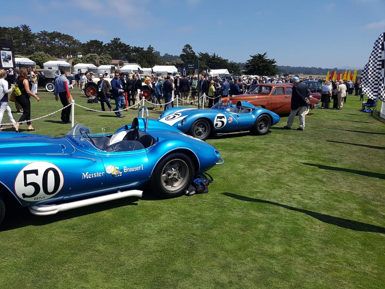 1958 Scarab race cars & Tuckers line Pebble Beach's fairway at this year's Concours d'Elegance