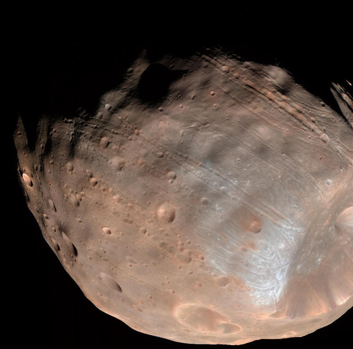 The grooves on the surface of Mars' moon Phobos are caused by tidal forces with the planet that are slowly leading to the moon's destruction