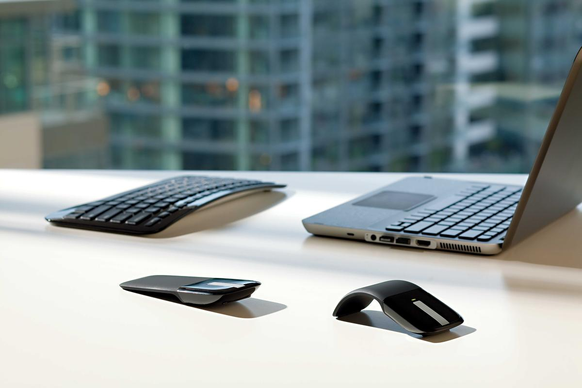 Microsoft has unveiled a touch sensitive version of its Arc mouse, the Arc Touch, which also includes a snap-in wireless transceiver and can be used on most surfaces