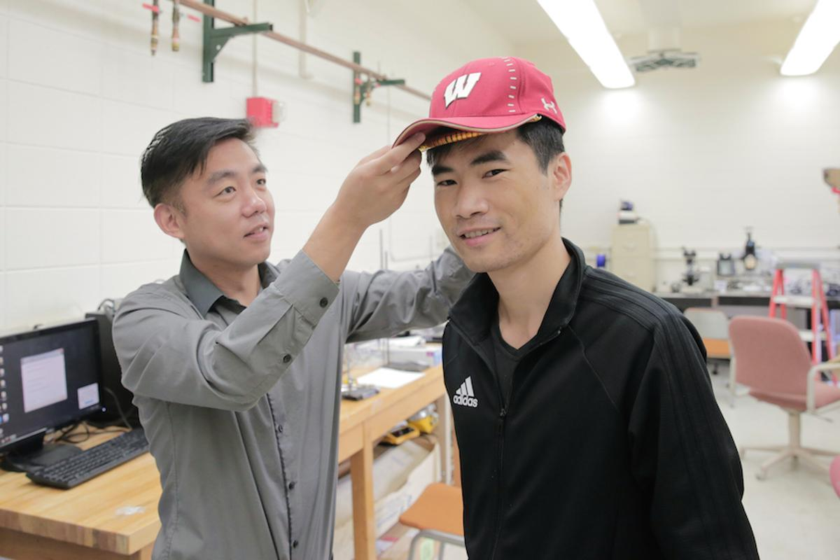 The hair-growth stimulating device is still being tested and in its prototype phase but the researchers demonstrate it is small enough to easily fit under a baseball cap