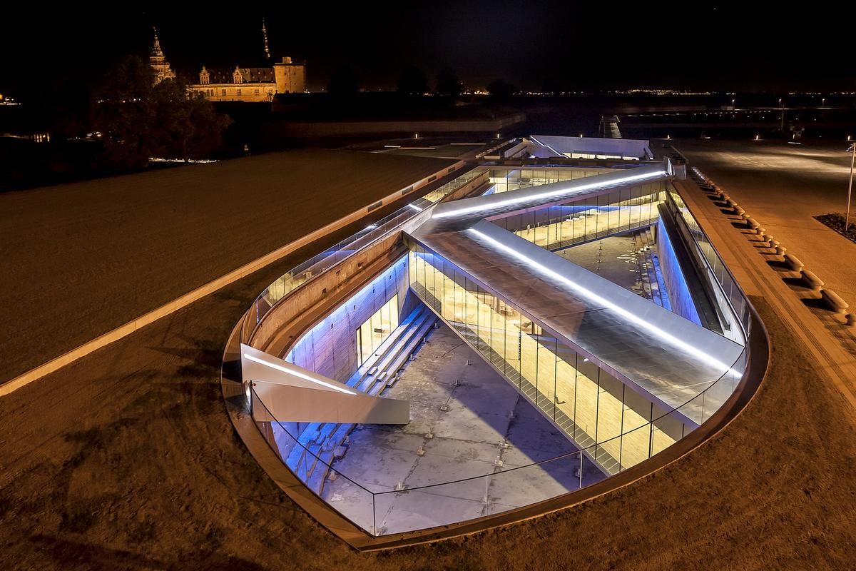 The museum is sunk into a former dry dock, and located adjacent to the historical Kronborg castle (Photo: BIG)