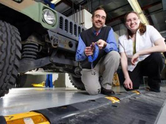 """Purdue associate professor of mechanical engineering, Douglas Adams, and graduate student Tiffany DiPetta with the speed bumplike """"diagnostic cleat""""Pic credit: Purdue News Service photo/Andrew Hancock"""
