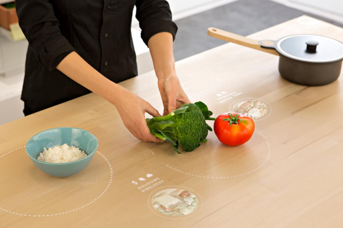 Placing food on the table of the Ikea Concept Kitchen 2025 calls up recommended dishes that use them