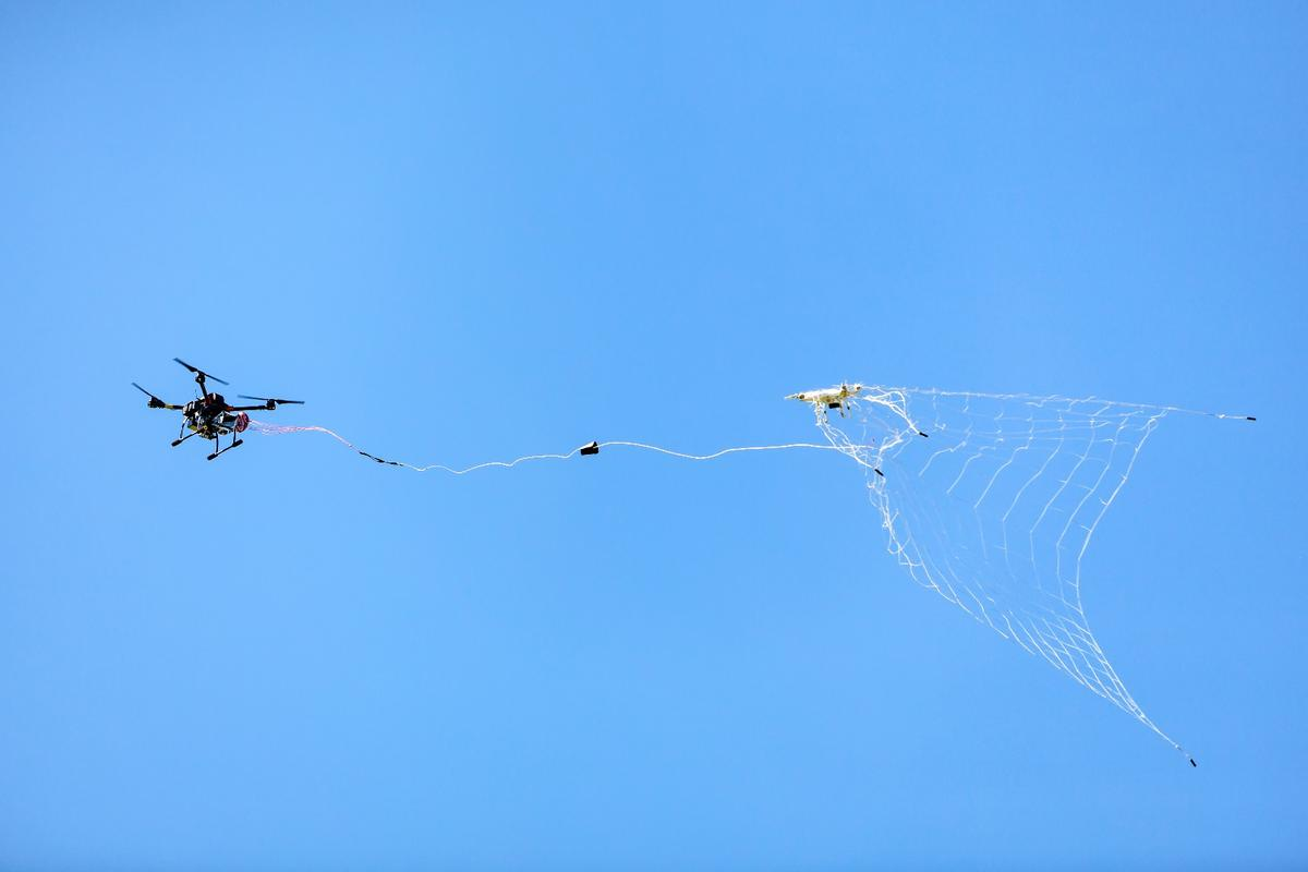 The DroneCatcher uses its pneumatic net gun to shoot a net at an intruding drone from a distance of up to 20 m (66 ft), capturing it