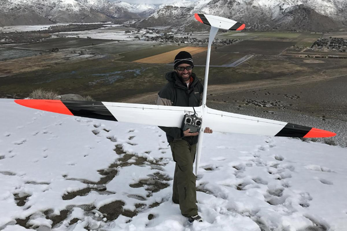 Spencer Lisenby with the massive DSKinetic 130-inch Transonic DP RC glider