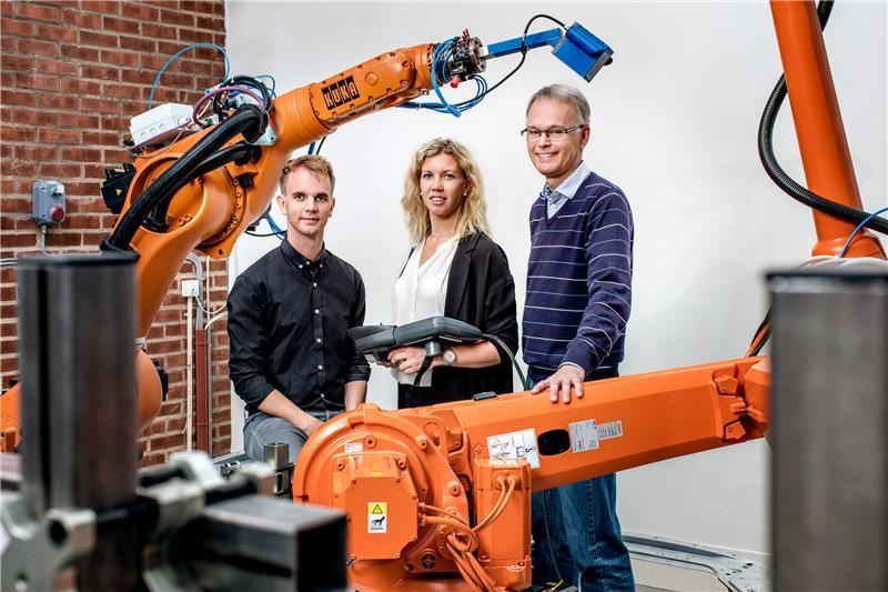 (Left to right) Dr Kristofer Bengtsson, master's student Emma Vidarsson, and Professor Bengt Lennartson in the Robotics and Automation Laboratory at Chalmers University of Technology