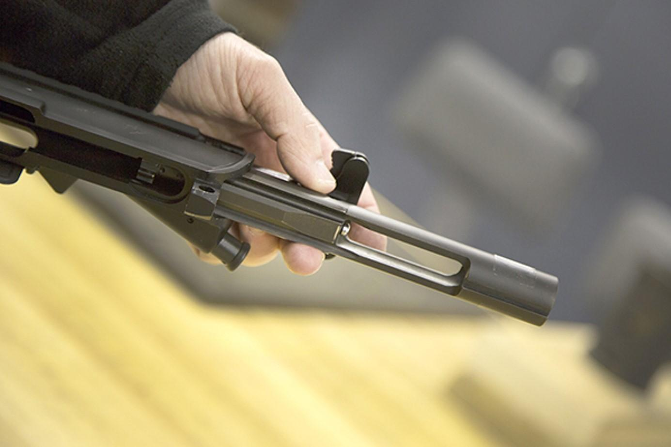Covered with a durable solid lubricant, the bolt and bolt carrier assembly are inserted into a weapon's upper receiver