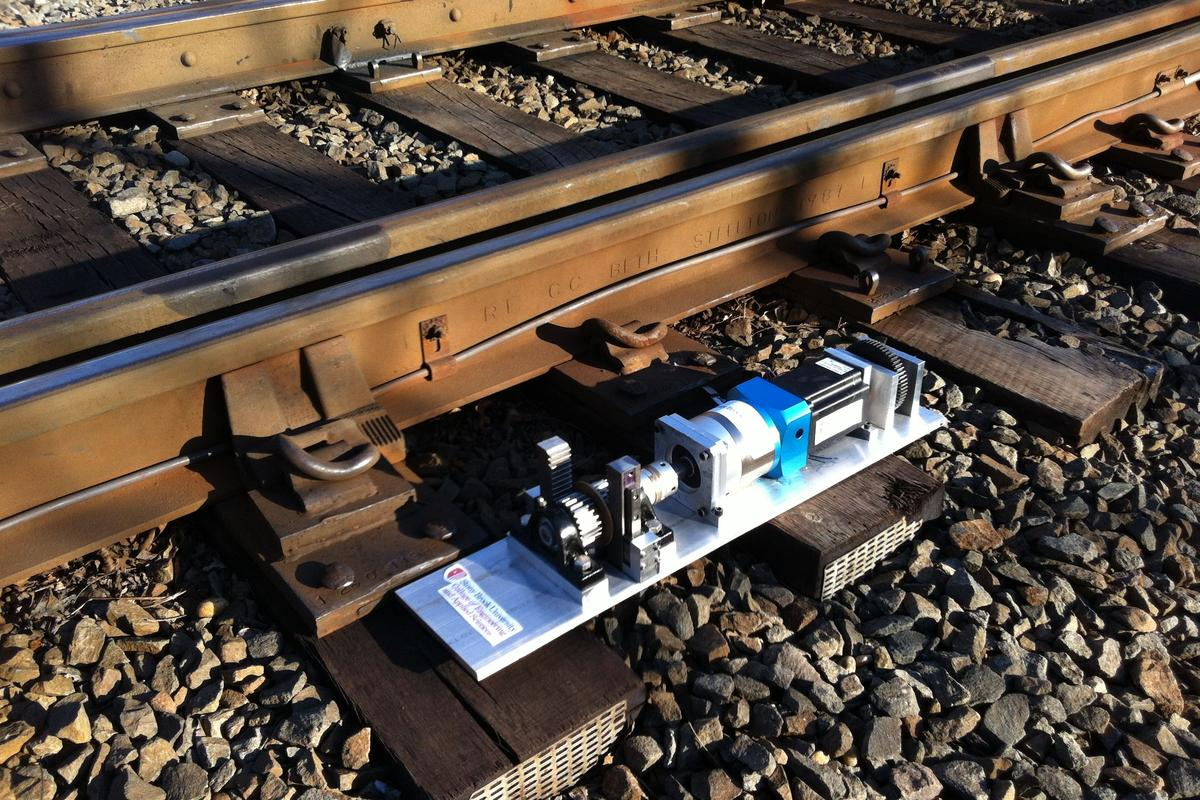Researchers from Stony Brook University have developed a device capable of harvesting energy from train-induced rail track vibrations to power signal lights, structural monitoring systems or even track switches (Image credit: Lei Zuo)
