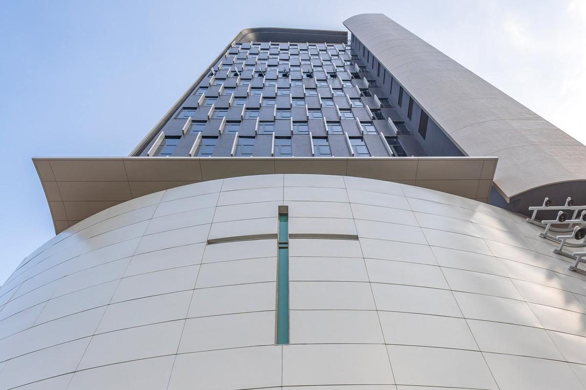 Wesleyan House Methodist International Church fits a 11,000 sq m (roughly 118,400 sq ft) house of worship into a small and awkward inner-city plot