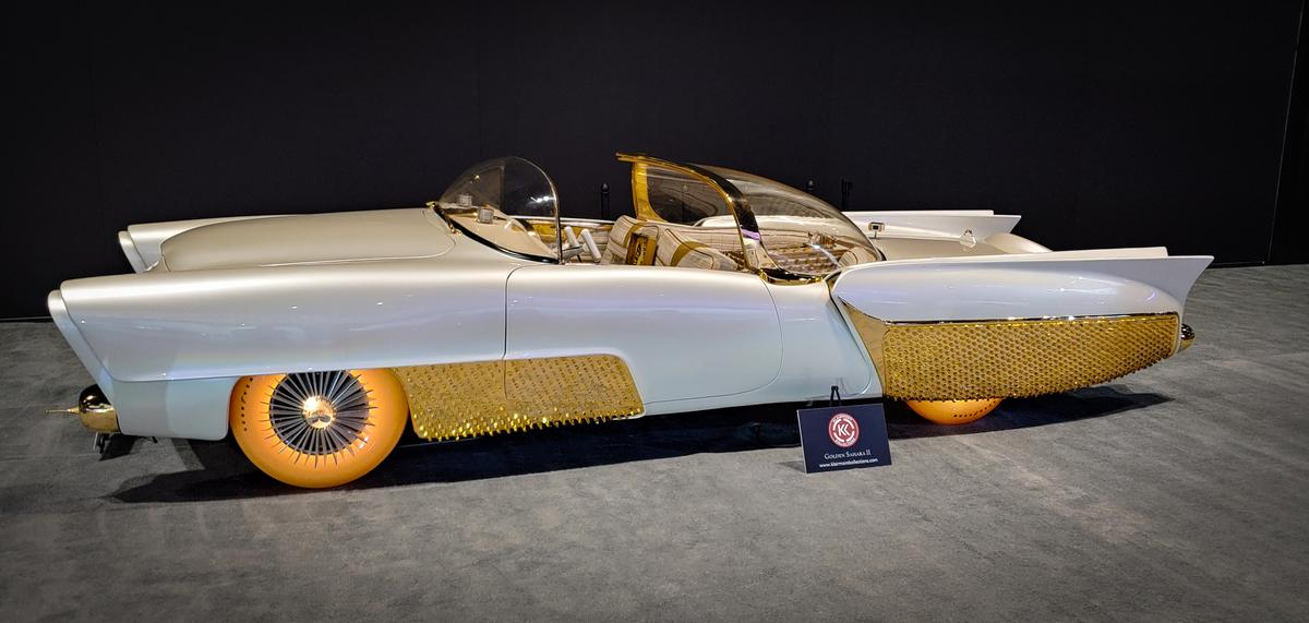 Sometimes oddballs hit you in the face so hard, you kind of fall for them. This Golden Sahara concept has $30,000, color-changing, illuminated tires and a cocktail lounge in the back seat