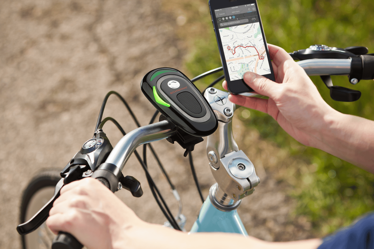 The CycleNav is paired with the user's safely-stowed smartphone