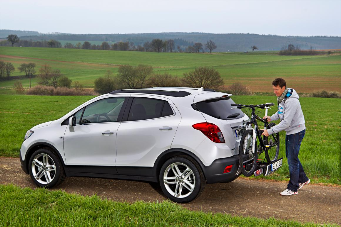 Opel's new Mokka crossover has an available FlexFix bicycle carrier built into its bumper, which holds up to three bikes (© GM Company)