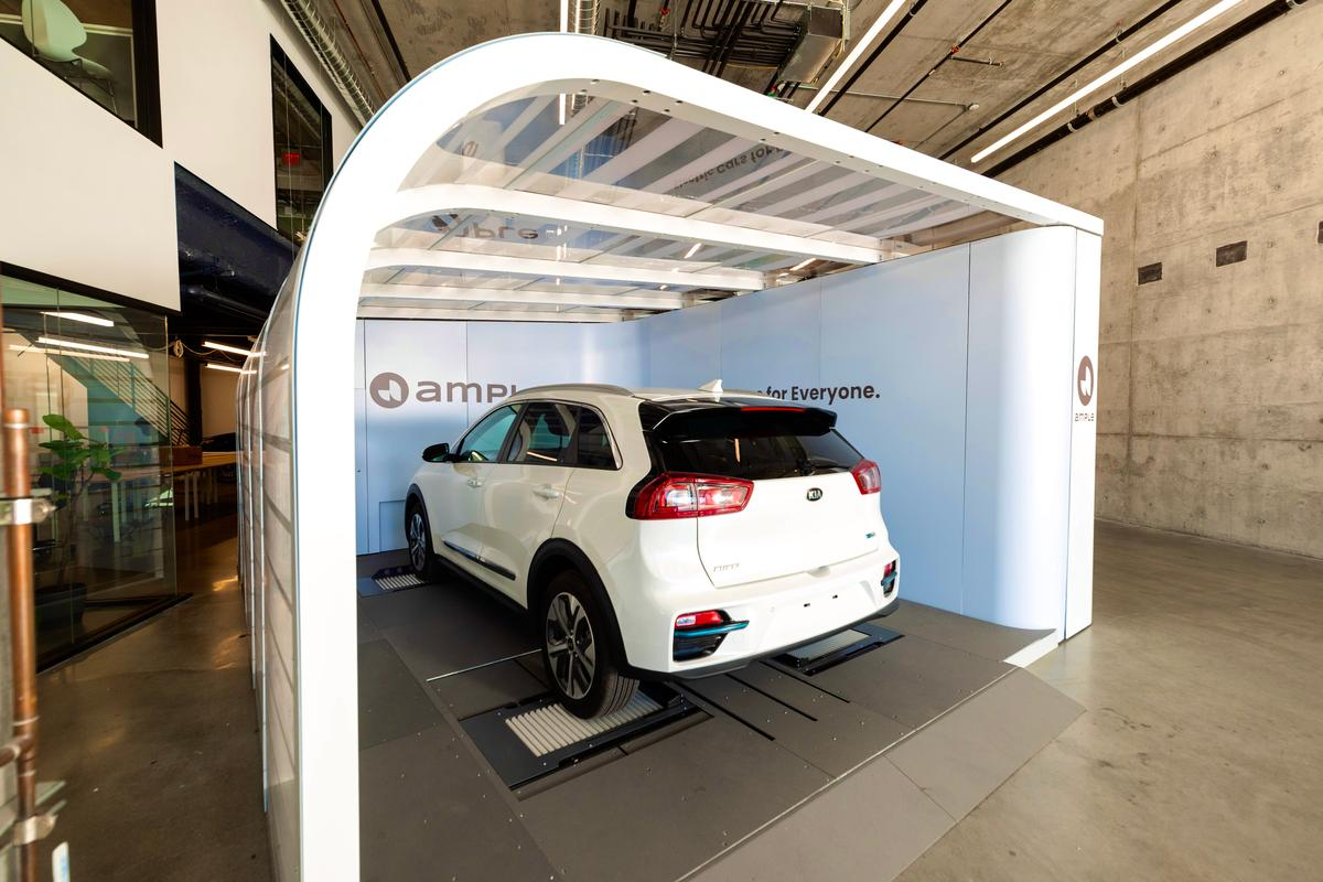 An electric vehicle could have it's old battery modules removed and a fully charged set installed in under 10 minutes