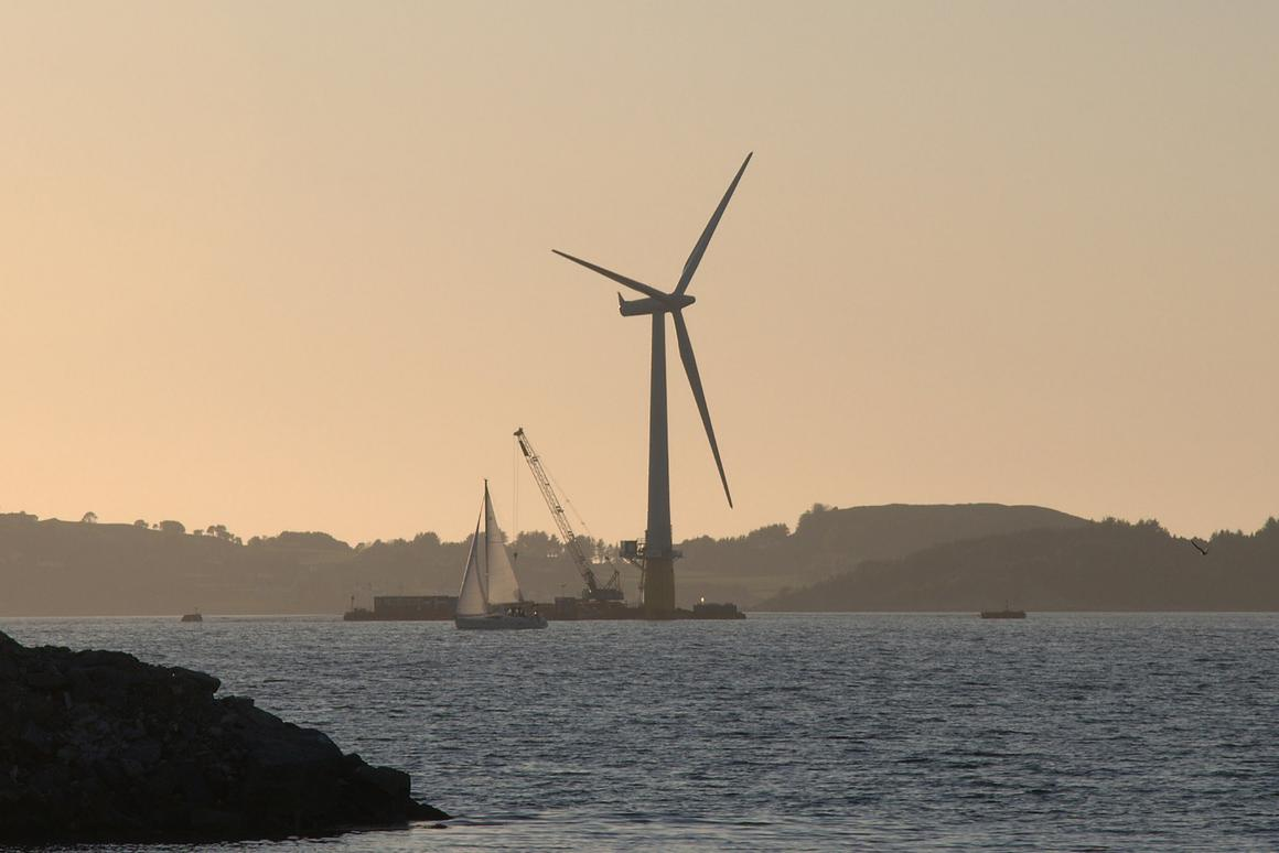 The world's first full-scale floating wind turbine, Hywind, being assembled off Norway before being deployed to the North Sea