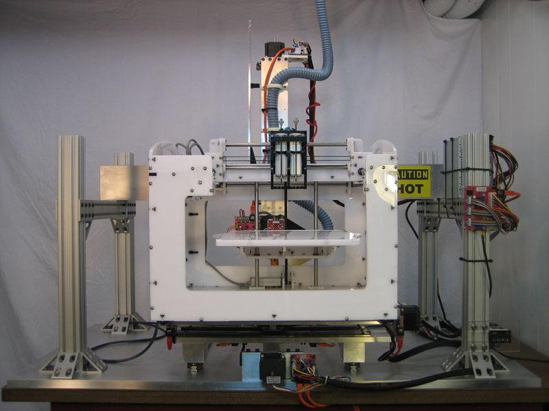 A Fab@Home Model 2.0 placed on the build plate of Jim Smith's home-built, large-scale 3D printer to show scale